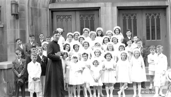 Br. John F. Koelzer, CSV, with First Communion class on the steps of St. Viator Church in Chicago, 1941